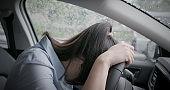 woman feel depressed in car