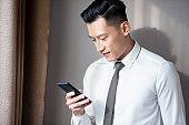 Asian businessman use cellphone