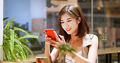 Young woman use mobilephone happily