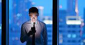 man use smartphone at night
