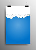 Cloudy sky poster template hanging on clip binders.