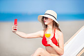 bikini woman take selfie