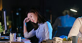 businesswoman feel tired at night