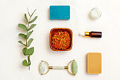 Modern apothecary. dry  marigold herbs and skin care products. Flat lay