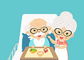 grandmother takes care of feed and take a drug the grandfather.