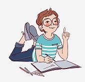 Little, cute boy writing in notebook