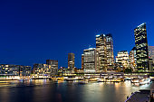 Sydney skyline at night. Business office buildings and Circular Quay cityscape