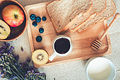 Homemade and Breakfast Food With Hot Milk, Whole Wheat Bread, Apple, Blueberry Kiwi Fruit and Honey on a Table., Nutrition Food and Drink, Top View Concept