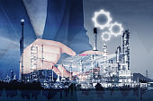 Business Accounting and Financial Trading Double Exposure Concept, Closeup of Business Woman Using Calculator Against Oil Refinery Plant Background., Strategy Marketing estate and Corporation