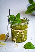 Basil pesto with parmesan ready to serve in a mason jar