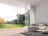Modern living room with large open door to nature 3d render