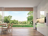 Modern kitchen and dining room with nature view 3d render