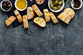 Italian food Cooking Italian bruschetta Olives fresh baguette slices olive oil garlic rosemary