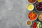 Set food cooking healthy vegetarian food Spiced chickpeas baked pumpkin and beets quinoa and vegetables with copy space top view