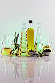 Bottles with organic cooking olive oil and olive branch