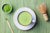 Matcha green tea latte in a cup. Top view. Organic product. Copy space.