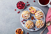 Muffins, cakes with cranberry and pecan nuts. Christmas decoration. Top view. Copy space.
