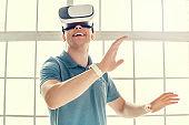 Man wearing virtual reality headset modern technology