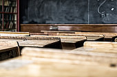 Antique Wood Desks and Blackboard in Old School Classroom