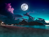 Beautiful view of the sea. Colorful blue sky with cloud and bright full moon on seascape to night. Serenity nature background.