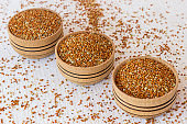 Grains of red millet  in a wooden box