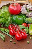Healthy food in full paper bag of different products, vegetables. Top view. Food background