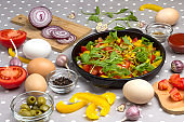 Set of vegetables for healthy eating, yellow and red peppers, olives, tomatoes,