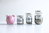 Images of coin in piggy bank for step up growing business to profit of each years and saving with piggy bank, Saving money for future plan education and retirement fund concept
