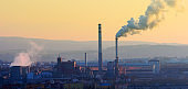 Cityscape with smoking stack from lignite combined heat and power plant plant  in Pilsen, Czech Republic.