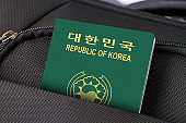 Close up of South Korea Passport in Black Suitcase Pocket