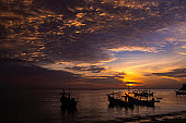 A morning sea landscape with boats silhouette and nice sky