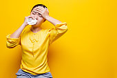 Woman use tissue paper after she sneezing