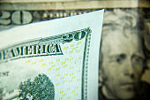 Twenty dollars bills - close up and reflection of US paper money