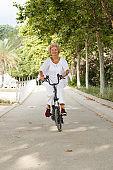 Mature woman cycling