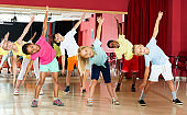 Boys and girls having dancing class in studio