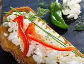 Toast with soft cheese and bell pepper