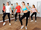 Teens practicing dance with female trainer