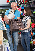 Happy family with dog choosing carrier box