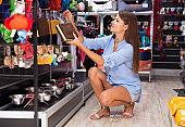 girl buyer choosing  new toy for dog