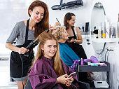 Girl talking on phone in hair salon