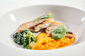 Cod fillet with pumpkin puree and spinach