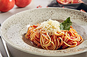 Italian Spaghetti with Amatriciana Sauce and Grated Cheese