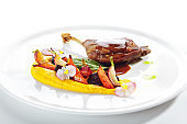 Fried Duck Leg with Young Vegetables, Flowers and Carrot Cream