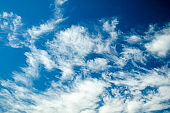 Beautiful clouds on a background of blue sky