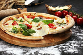 vegetarian italian Pizza with tomatoes, mozzarella cheese  and basil. Delicious italian pizza