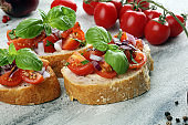fresh tomato bruschetta. italian food appetizer with basil on table
