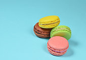 Many macaroons on a blue pastel background. Minimalism