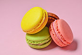 Many macaroons on a pink pastel background. Minimalism