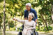 senior asian couple relaxing in park
