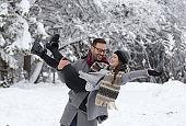 Happy couple enjoying on snow